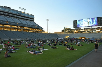 Guests sit on the field at Sun Devil Stadium
