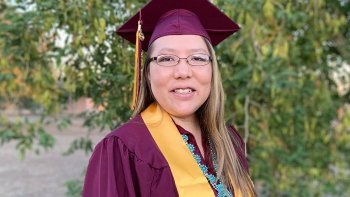 ASU graduate Stacee Tallman in her cap and gown