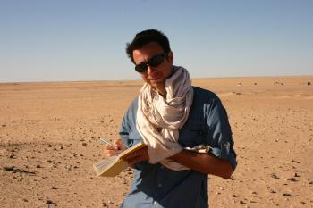 photo of Professor Christopher Stojanowski doing field research