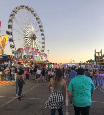 People walk the midway at the Arizona State Fair