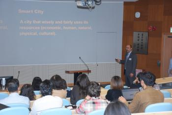 Rob Melnick presents about smart cities at Hong Kong event