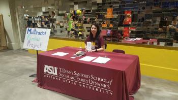 Picture of Annabelle sitting at table during recruitment.