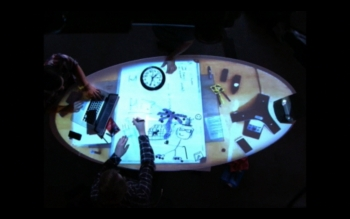Tabletop overhead view of interactive projection on table