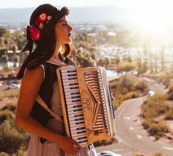 Tatiana Crespo poses outdoors in Phoenix with her accordion