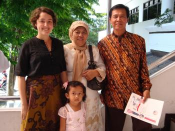 Peace Corps volunteer Taylor Rose (left) with her host family in Indonesia