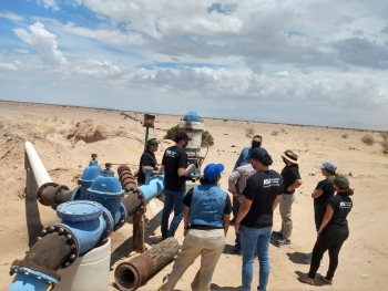 TEAM students examine ground water supply well in desert
