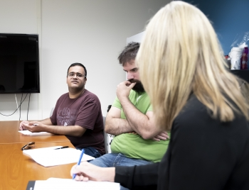 Zain Bukhari, a doctoral student at The College's School of Life Sciences, speaks to Linda Raish during a meeting for The College Ambassadors this summer.