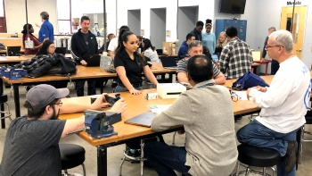 people gathered around a table for a Social Innovation Startup Lab meeting