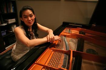 woman sitting at piano