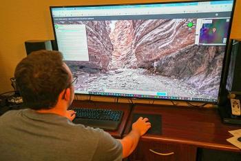 Man on computer exploring a canyon through a virtual field trip