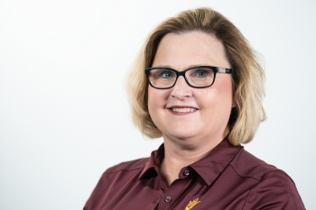 Vicki Sowards poses for a headshot in an ASU polo