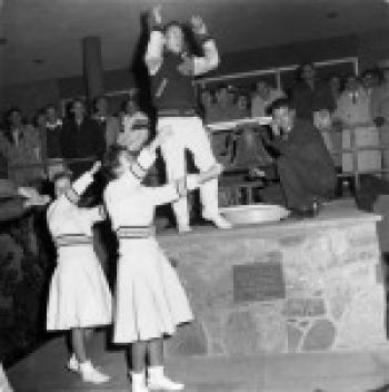 cheerleaders ring victory bell
