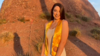 Edson College Outstanding Graduate Kaitlyn Weeks poses for graduation pictures wearing a gold graduation stole