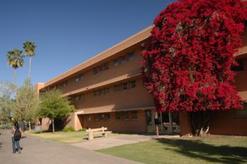 ASU's Wilson Hall, a three-story brick building with fuchsia bougainvillea.