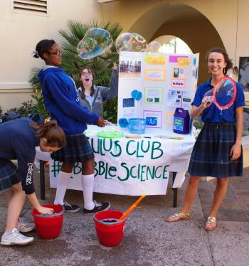 Girls give bubble science demo