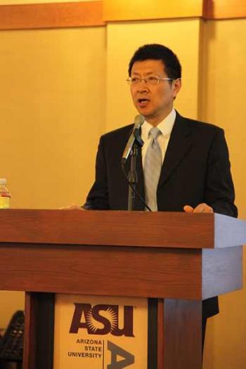 man standing at podium