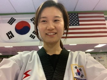 Graduating ASU student Young Wha Lee poses in her Taekwondo practice / Courtesy photo