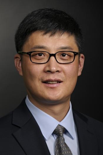 headshot of ASU professor John Zhang