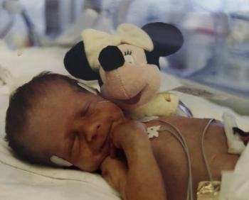 Baby Taylor Zimelman next to a stuffed animal