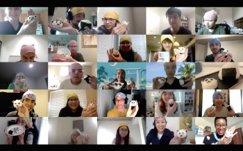 A screenshot shows 25 small images of workshop participants, taken over Zoom. Each person is holding up onigiri, a Japanese rice ball, that has been shaped to look like a panda.