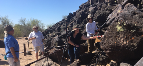 photo of archaeology team photographing petroglyphs