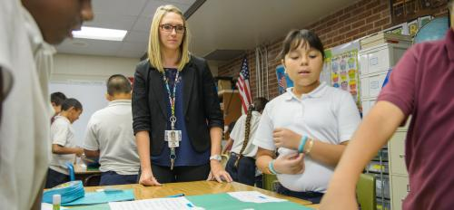 ASU graduate Lauren Edgar works with students