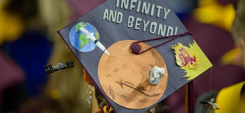 "graduation cap that says ""To infinity and beyond"""
