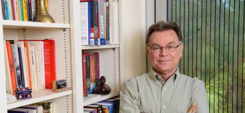 man standing near bookcase