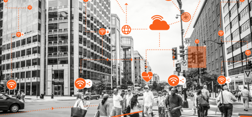 "People crossing a city sidewalk. The caption reads: A new project at ASU, ""Citizen Centered Smart Cities and Smart Living,"" aims to take an interdisciplinary approach to understanding and developing smart cities with individual citizens at the forefront o"