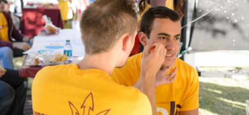 ASU students get their faces painted for Game Day