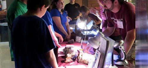 community members look at meteorites and engage with ASU scientists