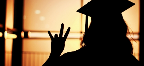Silhouette of a grad with cap and gown