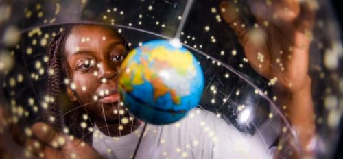 woman looking at a globe