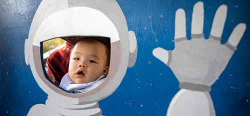 leo long poses in space man cutout at open door