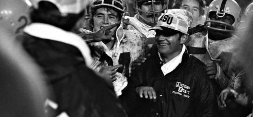 ASU Coach Frank Kush and football players