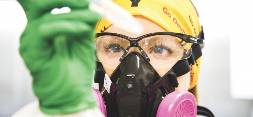 researcher in a lab wearing PPE
