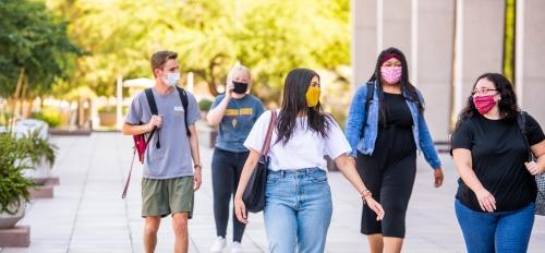 Students wearing masks and social distancing
