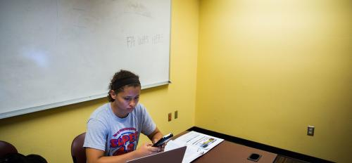 woman in study hall working on computer