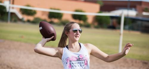 Woman throwing football