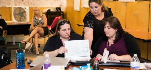Nicole Aveni assists her students Melissa Sullivan, left, Hillary Golson, right, during their course at Longview School