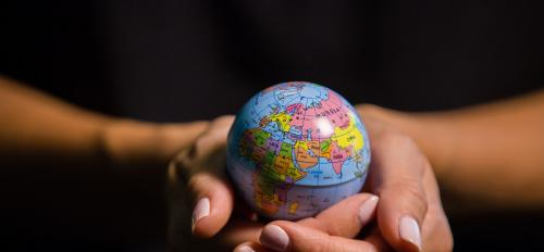hands holding small globe