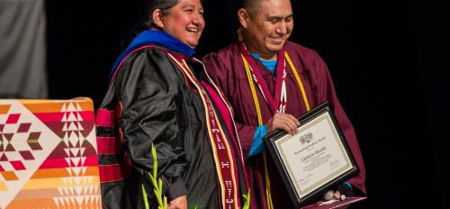 Professor presents the Dean's Medal to American Indian Studies graduate