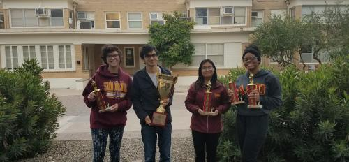 students holding trophies