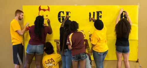 SAA game banner being painted