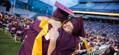 two people hugging at graduation