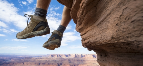 Feet hanging over Grand Canyon