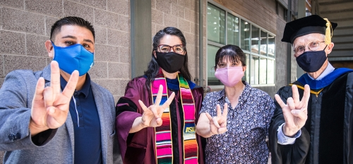 Faculty and students at Poly campus graduation event