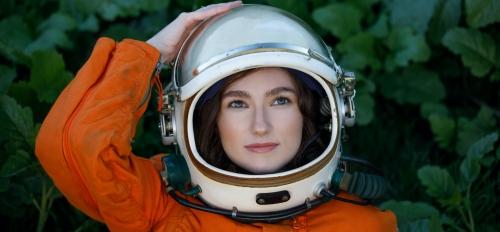 Emily Karlzen wearing a space helmet