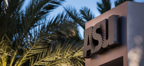 Arizona State University logo statue surrounded by palm leaves