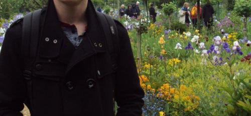 Jake Adler posing in a garden